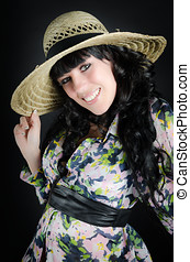 Beautiful smiling woman in straw hat