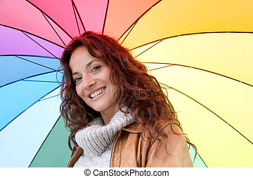 Beautiful smiling woman on a raining day
