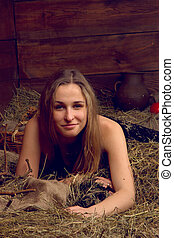 beautiful smiling woman on haystack at farm - beautiful...