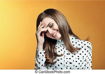 Beautiful smiling woman on yellow background
