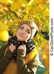 Beautiful smiling woman outdoor portrait