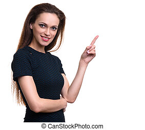 beautiful smiling woman pointing finger to copy space