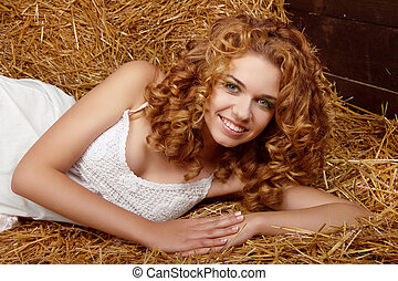 Beautiful smiling woman portrait with long curly hairs on...