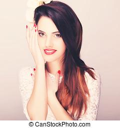 Beautiful smiling woman studio toned image. Professional...