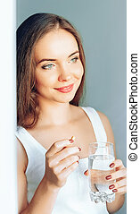 Beautiful Smiling Woman Taking Vitamin Pill. Dietary ...