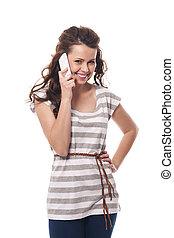 Beautiful smiling woman talking on mobile phone