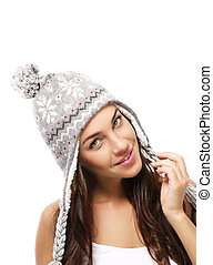 beautiful smiling woman wearing a winter cap on white background