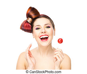 Beautiful smiling woman with a lollipop.