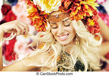Beautiful smiling woman with a lot of flowers