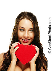 beautiful smiling woman with a red heart on white background