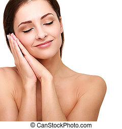 Beautiful smiling woman with clean skin and hands near the face. Closeup isolated portrait