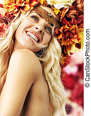 Beautiful smiling woman with colorful wreath