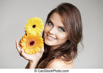 Beautiful Smiling Woman With Flower At Grey Background.