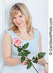beautiful smiling woman with rose