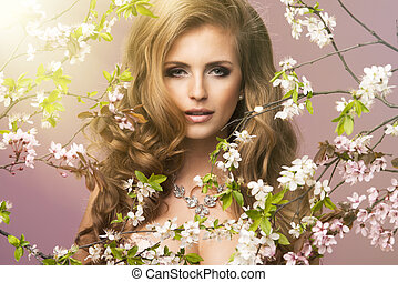 Beautiful smiling woman with spring