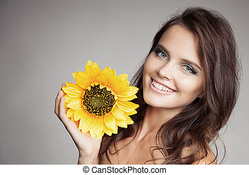 Beautiful Smiling Woman With Sunflower