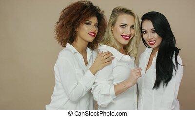 Beautiful smiling women friends in studio - Portrait of...