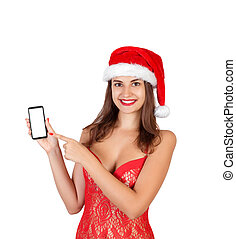 Beautiful smiling young girl in christmas hat and swimsuit presenting mobile phone. emotional woman in red santa claus hat isolated on white background. Happy Christmas and New Year holidays concept