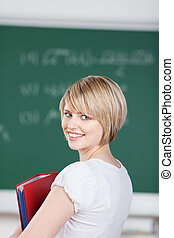 Beautiful smiling young woman in college