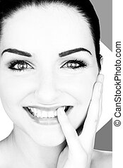 Beautiful smiling young woman - A black and white close up...