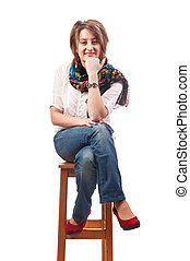 Beautiful smiling young woman sitting on a chair