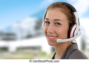 beautiful smiling young woman with a headset