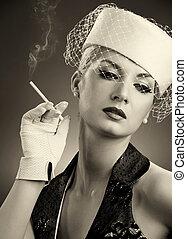Beautiful smoking woman. Retro portrait