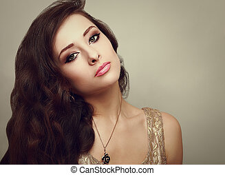 Beautiful smoky eyes makeup woman with long healthy brown hair. Closeup