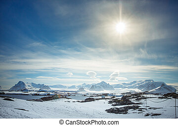 Beautiful snow-capped mountains against the blue sky in ...