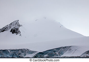 Beautiful snow-capped mountains against the sky. Antarctic landscape