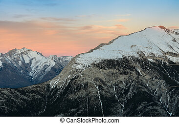 Beautiful snow capped mountains against the twilight sky at Banff National Park in Alberta, Canada.