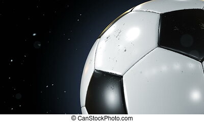 Beautiful Soccer Ball Rotating Close-up in Slow Motion on Black with Dust Particles Flying. Looped Football 3d Animation of Turning Ball. 4k UHD 3840x2160.