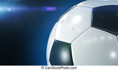 Beautiful Soccer Ball Rotating Close-up in Slow Motion on Black with Stadium Flare. Looped Football 3d Animation of Turning Ball. 4k Ultra HD 3840x2160.