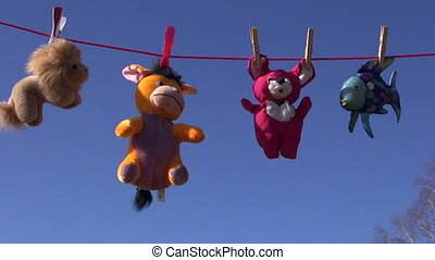 beautiful soft toys on clothes line - four beautiful soft...