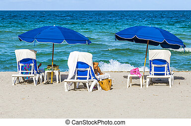 beautiful south beach with chairs and parasol in Miami - ...