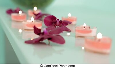 Beautiful spa composition with orchid flowers on table slow...