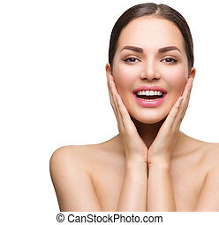 Beautiful spa girl looking at camera, touching her skin and smiling