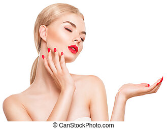 Beautiful spa girl showing empty copy space on the hand palm for text