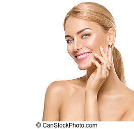 Beautiful spa girl touching her face and smiling