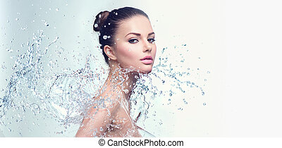 Beautiful spa woman with splashes of water