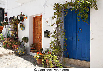beautiful spanish street decorated with flowers