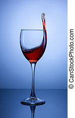 splash in a glass of red wine on a gradient background
