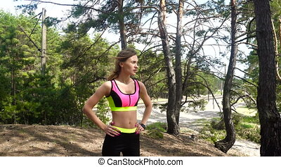 beautiful sport girl in the forest
