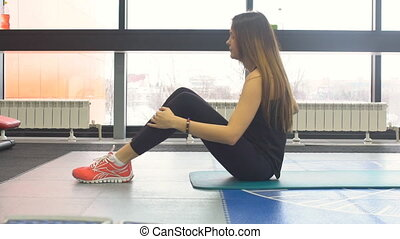 Beautiful sport woman doing press fitness exercise gym