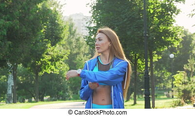 Beautiful sportswoman warming up before jogging in the park....