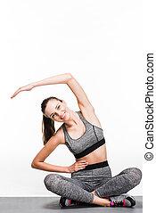 girl exercising on yoga mat