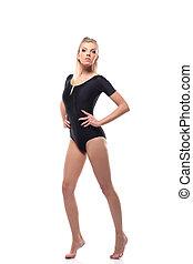 Beautiful sporty girl in black leotard