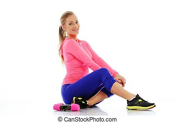 Beautiful sporty girl with dumbbells isolated on white background