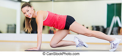 beautiful sporty woman doing exercise at gym