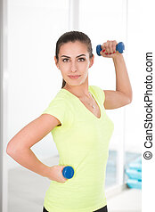 Beautiful sporty woman in gym